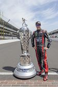 Indianapolis, IN - May 19, 2014:  Kurt Busch (26) poses with the Borg-Warner Trophy before practicin