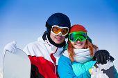 Smiling couple in ski masks together