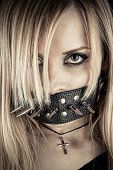 stock photo of sadomasochism  - portrait of a slave in BDSM theme gagged of thorns - JPG