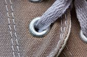 Eyelet Tab Of Canvas Shoe, With Shoelace, Close-up