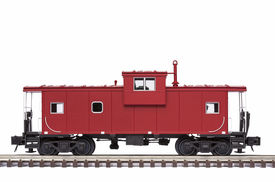picture of caboose  - A red railroad caboose on train track - JPG