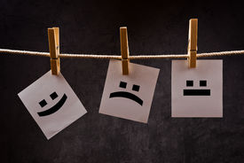 image of emoticon  - Emoticons printed on note paper attched to rope with clothes pins  - JPG
