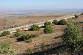 image of golan-heights  - The fence of the border between Israel and Syria as seen from a hill on the Golan Heights about 10 kilometers south - JPG
