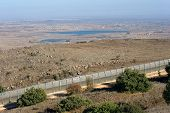 picture of golan-heights  - The fence of the border between Israel and Syria as seen from a hill on the Golan Heights about 10 kilometers south - JPG