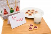 Milk and cookies left out for santa on white background