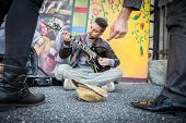 stock photo of beggar  - Street artist peforming om the streets  - JPG