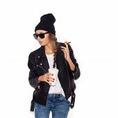 stock photo of teen smoking  - Hipster girl in sunglasses and black beanie smoking cigar - JPG