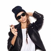 Young Sexy Woman In Sunglasses And Black Leather Jacket Smoking Cigar