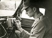 SOCZEWKA, POLAND, CIRCA SIXTIES: Young soldier exercises  in car during a military training