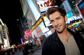 image of broadway  - Man standing in Time Square on Broadway street - JPG