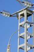 high voltage pylon with blue sky