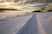 Walkway along the frozen waterfront of Summerside Harbor, Prince Edward Island, Canada.