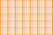 Closeup of a fabric with a colorful checked pattern