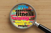 Fitness concept tag cloud under a magnifying glass from above (3D Rendering)