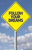 Creative sign with the message - Follow your Dreams