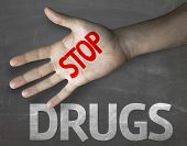 stock photo of crack addiction  - Creative composition with the message Stop Drugs - JPG