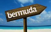Bermuda wooden sign with a beach on background