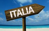 Italia wooden sign with a beach on background