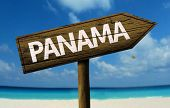 Panama wooden sign with a beach on background