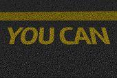 You Can text on the asphalt
