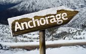 Anchorage , Alaska wooden sign with a snow background