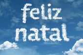 Amazing Merry Christmas ( Feliz Natal in Portuguese ) text on clouds