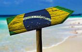 foto of bandeiras  - Brazil flag wooden sign with a beach on background  - JPG