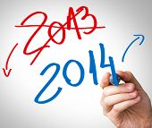 stock photo of reveillon  - Hand writing with a red and blue mark on a transparent board show that 2013 year is over and 2014 are coming - JPG