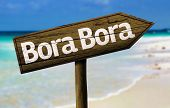Bora Bora wooden sign with a beach on background - French Polynesia