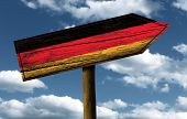 Germany flag wooden sign with a beautiful sky on background - Europe