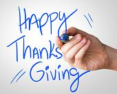 picture of give thanks  - Happy Thanks Giving hand writing with a blue mark on a transparent board - JPG