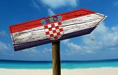 Croatia flag wooden sign with a beach on background - Europe