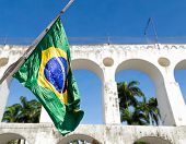 The flag of Brazil and the Lapa Archs in Rio de Janeiro, Brazil