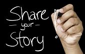 Share your story hand writing with white marker on transparent wipe board