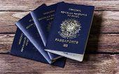 New Brazilian Passport on the wooden table