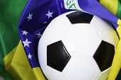 Soccer ball and the flag of Brazil