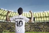 German soccer player celebrates with the fans on the stadium