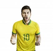 Brazilian soccer player celebrates isolated on white background