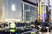 TOKYO, JAPAN - CIRCA MAY 2014: Shoppers and tourists pass by a large Apple store in Ginza in Tokyo, Japan.