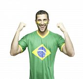 Brazilian soccer fan celebrates on white background