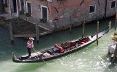 Gondolier in the process of mooring his Gondola