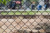 Metal Mesh Wire Fence With Blur Factory Background