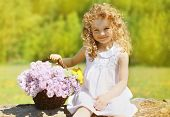 Summer Sunny Portrait Charming Curly Little Girl With Floral Basket