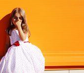 Street Fashion Little Girl In Dress Near Colorful Wall