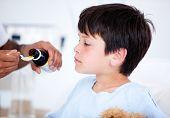 Cute Sick Little Boy Taking Medicine