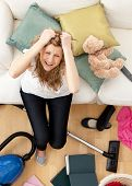 Stressed Young Woman Doing Housework