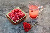 Guelder rose jam, fresh viburnum and tea viburnum on old wood background