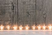 Star Lights Against Wooden Background