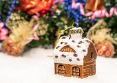 House With Christmas Decorations On A White Backgrond
