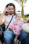 Young Father And His Baby Girl At Mediterranean Resort
